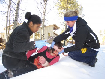 Students practicing wilderness first aid skills.
