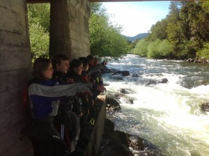 Students work together to scout a rapid on the Trancura River