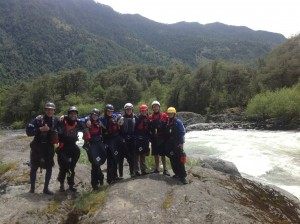 The whole group checks out Pescador, the biggest rapid of the weekend on the Rio Trancura