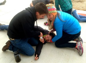 Austin and Emma making sure to clear Becca's airway during an afternoon simulation.