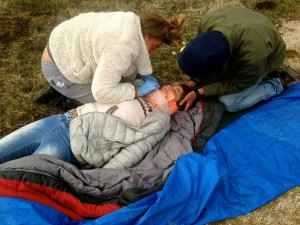 "Two of our students, rescuers, tending to an ""injured"" patients during an afternoon simulation"